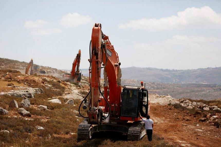 Heavy machinery work on a field as they begin construction work of Amichai, a new settlement which will house some 300 Jewish settlers evicted in February from the illegal West Bank settlement of Amona, in the West Bank on June 20, 2017.
