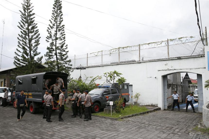 Indonesian Police gear up in front of the Kerobokan prison as they start an investigations into four foreign prisoners who escaped, reportedly using a tunnel, in Bali, on June 20, 2017.