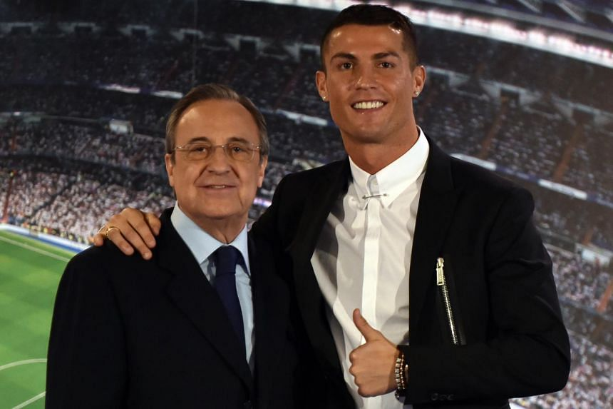 Real Madrid's forward Cristiano Ronaldo (right) and club president Florentino Perez posing during the official presentation of Ronaldo's contract renewal, in the presidential box at the Santiago Bernabeu stadium in Madrid on Nov 7, 2016.