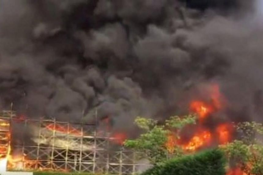 Fire engulfs a distribution center in central Tokyo, on June 20, 2017.