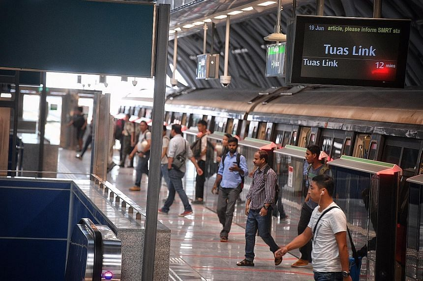 Above: Commuters disembarking at Gul Circle MRT station on the Tuas West Extension line yesterday morning. The line opened on Sunday. Left: Most of the carriages on the line, an extension of the East West Line, were empty yesterday morning.