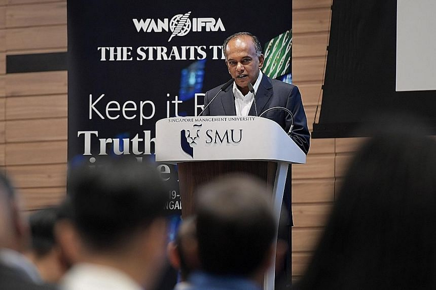 Law and Home Affairs Minister K. Shanmugam delivering the opening address yesterday at the conference on fake news.