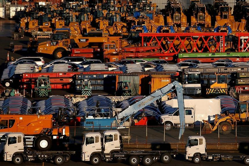 Newly manufactured vehicles awaiting export at a Yokohama port in this January file photo. Japan's exports to the US rose by 11.6 per cent last month from a year ago due to an increase in shipments of cars and auto parts.