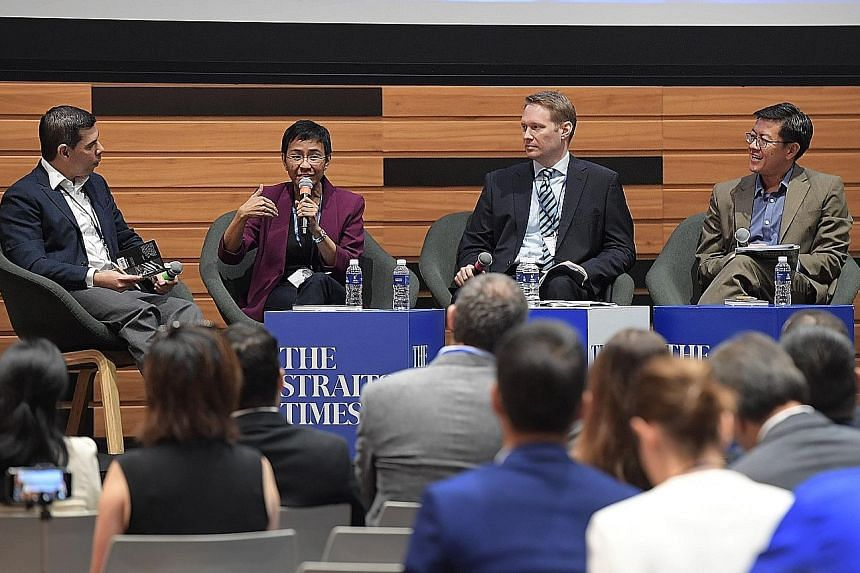 (From left) ST editor and panel moderator Warren Fernandez with Rappler CEO Maria Ressa, Reuters managing editor Jason Subler and Singapore Management University law don Eugene Tan at the forum yesterday.