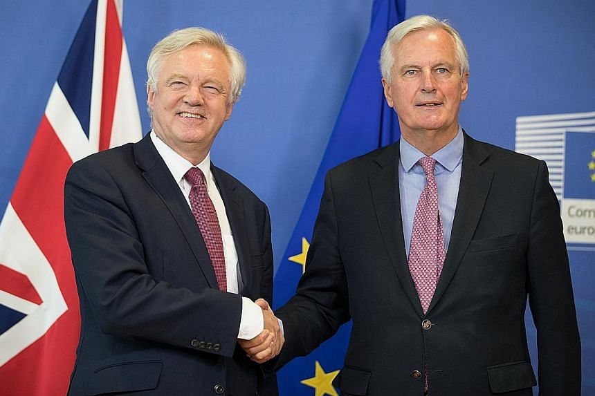British Brexit Minister David Davis (far left) and the EU's chief negotiator, Mr Michel Barnier, started the talks on a positive note.