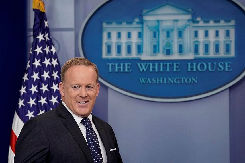 Sean Spicer arrives for his daily briefing at the White House in Washington on June 12, 2017.