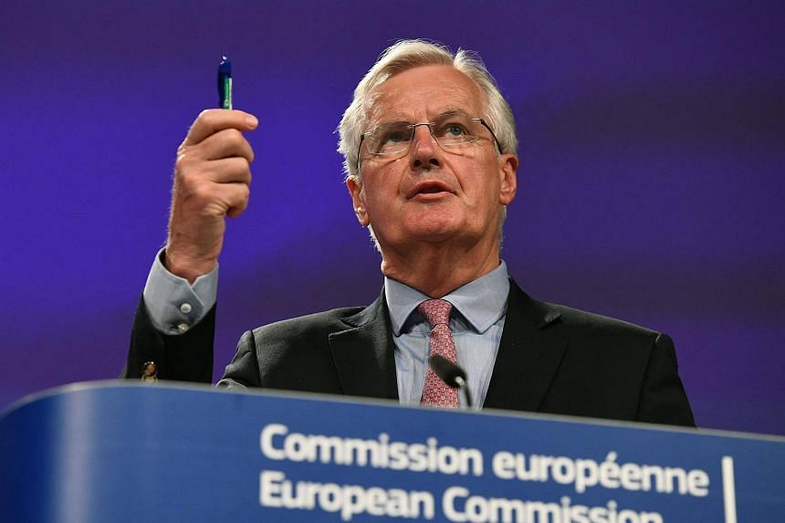 European Commission member in charge of Brexit negotiations with Britain, Michel Barnier gestures as he addresses a press conference.