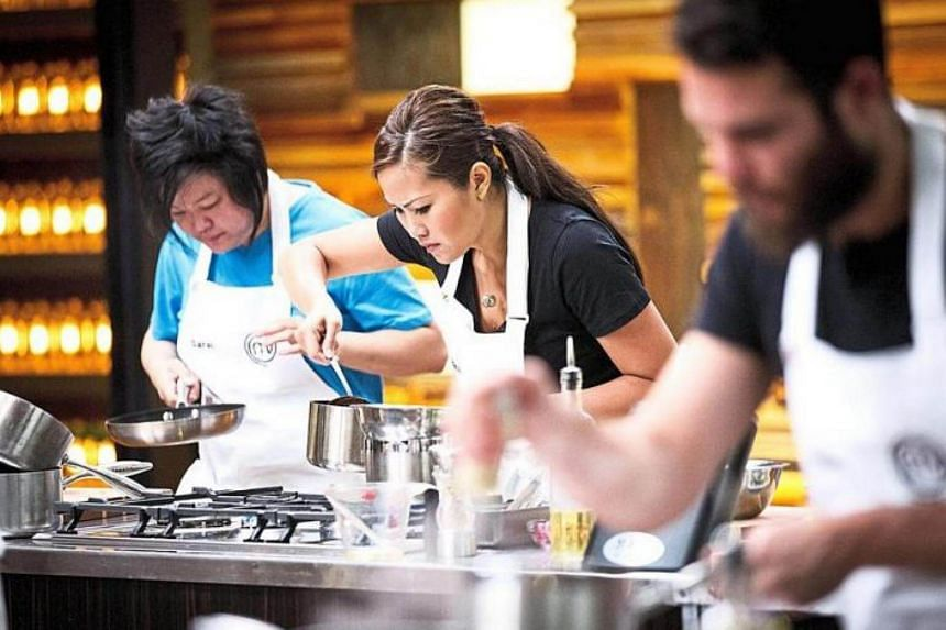 Sarah Tiong (left) and Diana Chan cook side by side in the MasterChef kitchen.