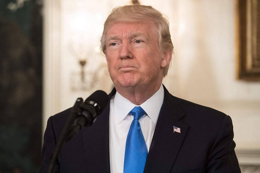 US President Donald Trump delivers a statement in the Diplomatic Room at the White House in Washington, DC.