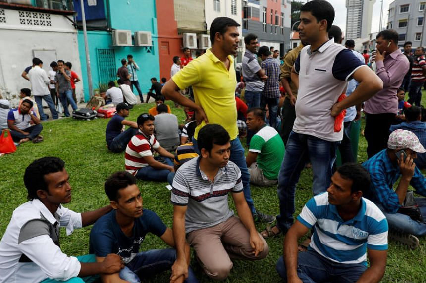 Bangladeshi workers hang out with friends at Little India on April 2, 2017.