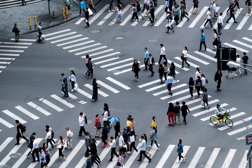 Cities in four Chinese provinces have started using facial recognition technology to shame jaywalkers who cross the roads when the lights are red.