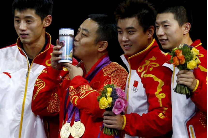 Chinese coach Liu Guoliang celebrating with (from left) Zhang Jike, Wang Hao and Ma Long their gold at the medal ceremony of the men's team event in the 2012 Olympics. He is set to be the vice-chairman of the China Table Tennis Association.