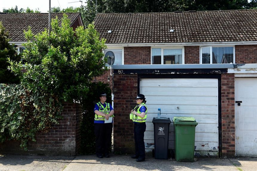 Police officers stand outside the home of Darren Osborne, in Cardiff, Wales on June 20, 2017.