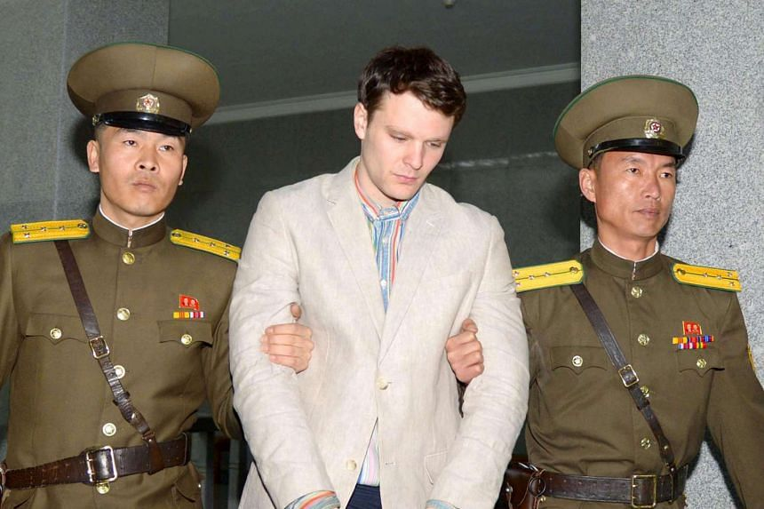 Otto Frederick Warmbier (centre) is taken to North Korea's top court in Pyongyang, North Korea, in this photo released by Kyodo on March 16, 2016.