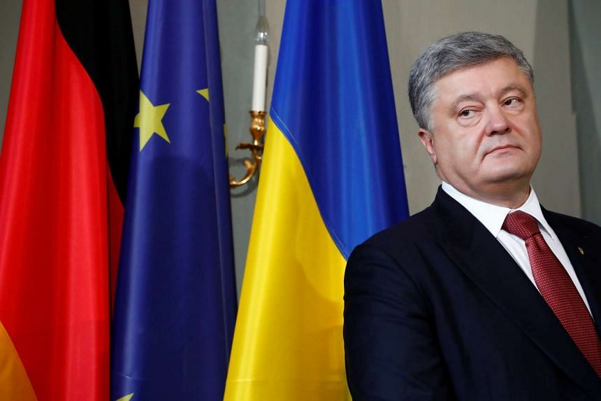 Ukrainian President Petro Poroshenko addresses the media after a meeting in Germany on May 20, 2017.