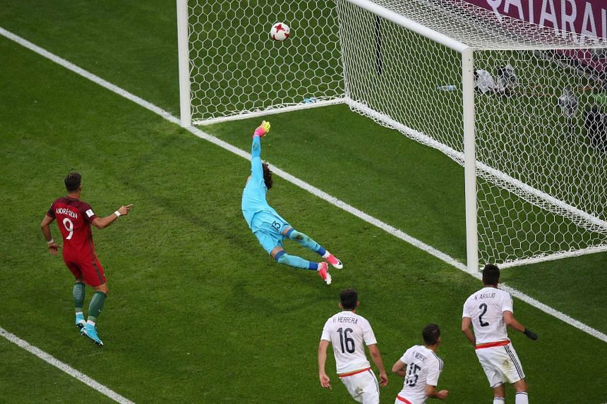 Mexico 'keeper Guillermo Ochoa failing to save an 86th-minute goal from Portugal right-back Cedric Soares (not pictured) in a Group A match at the Confederations Cup. Portugal next play hosts Russia, while Mexico face New Zealand.