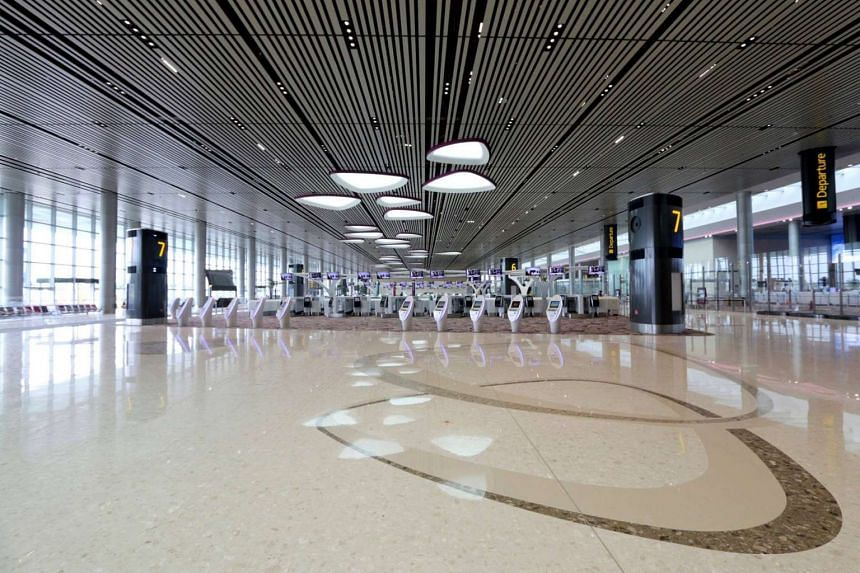 The departure hall features a high ceiling with petal-shaped skylights.