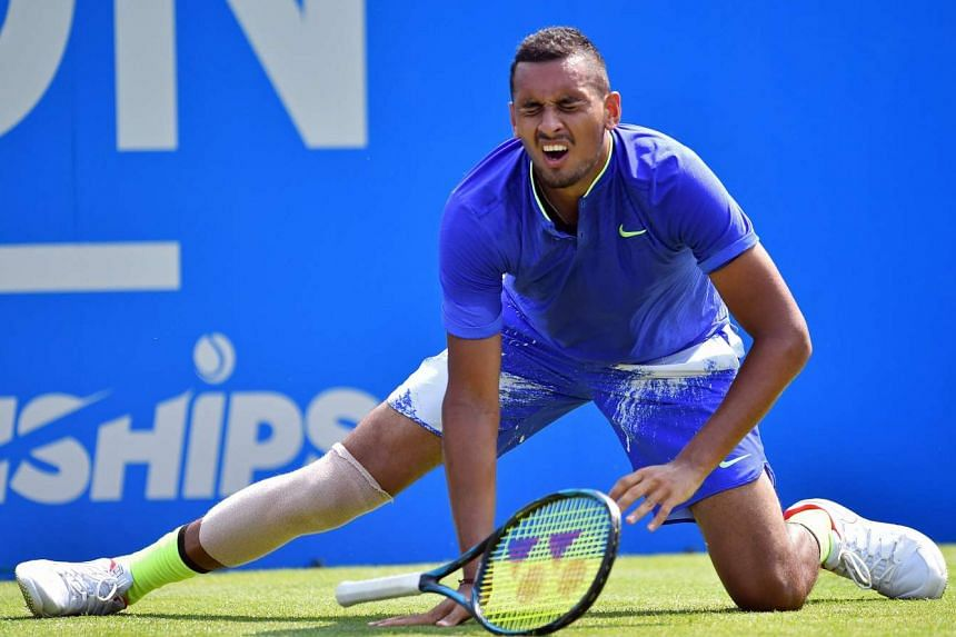 Australia's Nick Kyrgios slipping during his first-round match against Donald Young of the US at the ATP Aegon Championships tennis tournament at Queen's Club in west London on June 19, 2017.