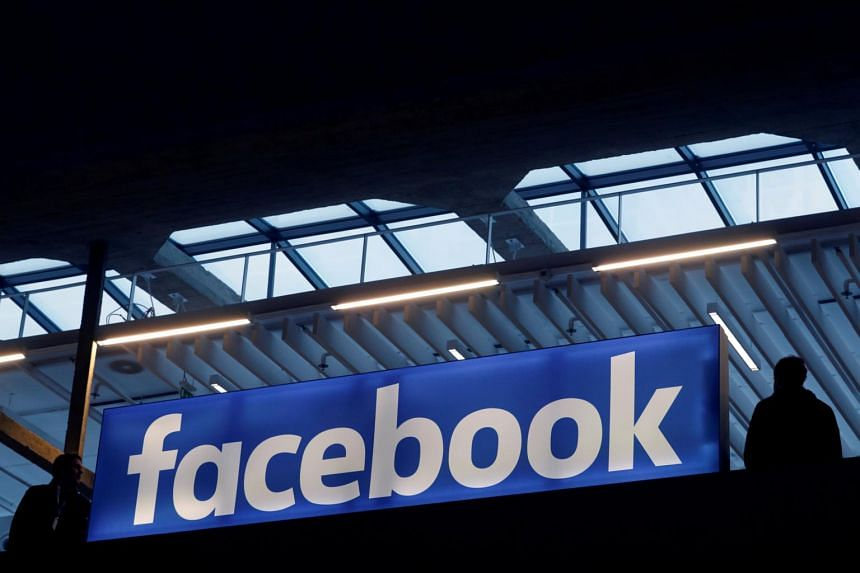 The Facebook logo is seen at a start-up companies gathering at Paris' Station F.
