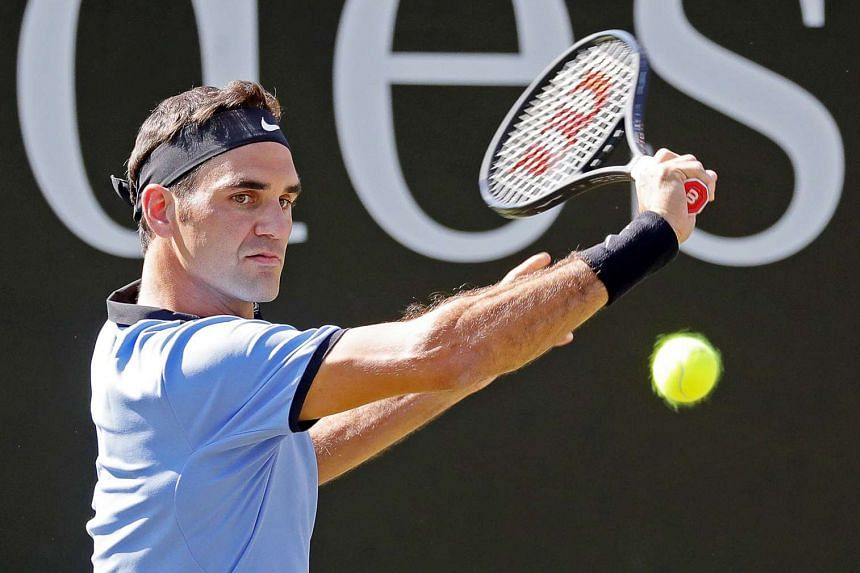 Federer (above) beat Japan's Yuichi Sugita in the first round at Halle.