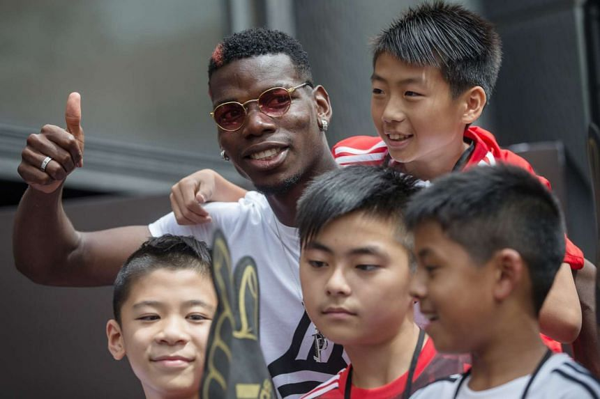 Manchester United central midfielder Paul Pogba with aspiring local players during a promotional event in Hong Kong on June 19, 2017. His agent Mino Raiola is believed to have pocketed some €49 million from his move from Juventus to Manchester Unit