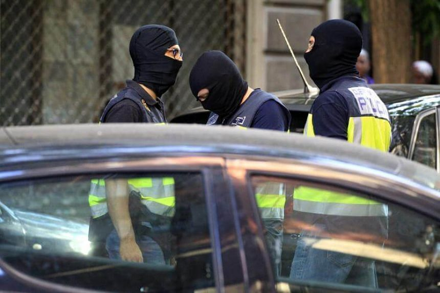 Spanish National policemen arrive for a search at a residence where three Moroccan jihadist suspects were arrested in Madrid, Spain, on June 21, 2017.