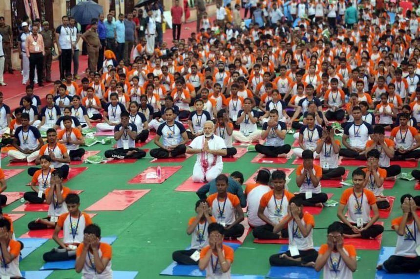 Indian Prime Minister Narendra Modi performs yoga to mark the international Day of Yoga, in Lucknow, Uttar Pradesh, India, on June 21, 2017.