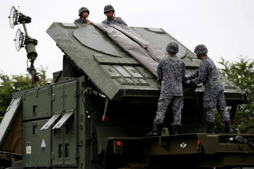 Japan Self-Defense Forces (JSDF) soldiers hold a drill to mobilise their Patriot Advanced Capability-3 (PAC-3) missile unit in response to recent missiles launch by North Korea, at JSDF Asaka base in Asaka, north of Tokyo, Japan, on June 21, 2017.