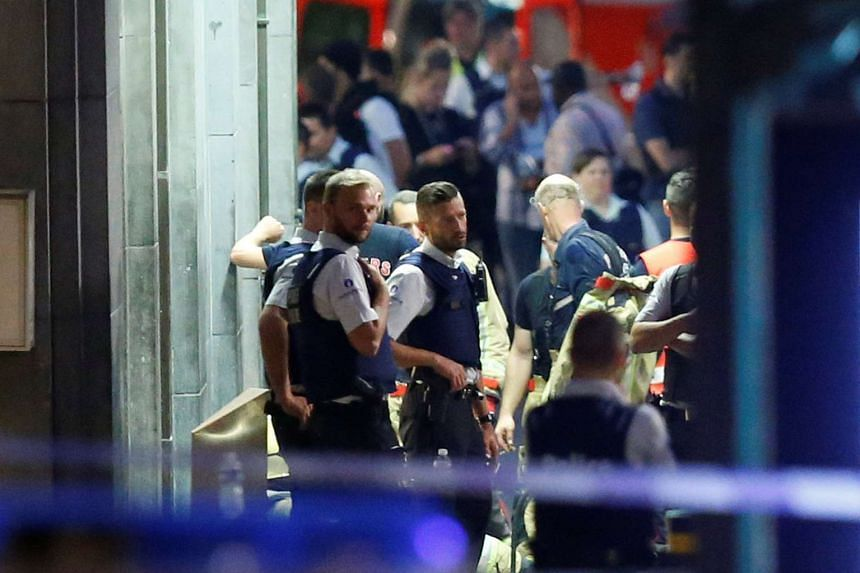 Belgian police take up positions in Brussels' central station after a terrorist incident.
