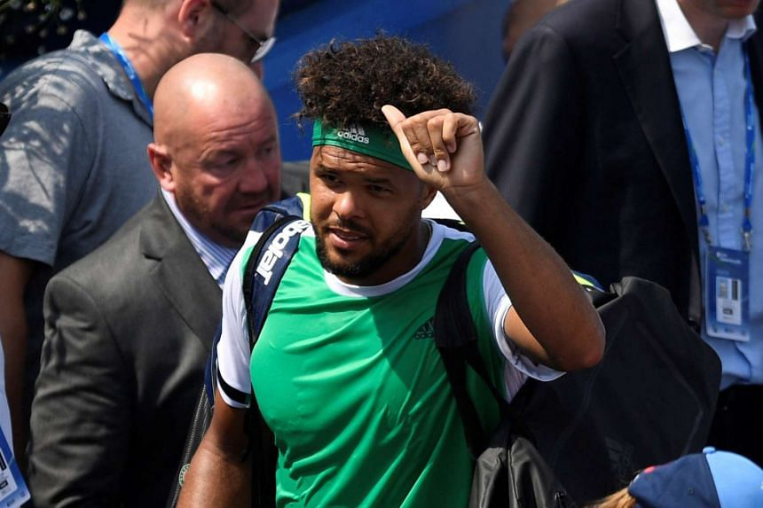 Tsonga looks dejected after losing his second round match.