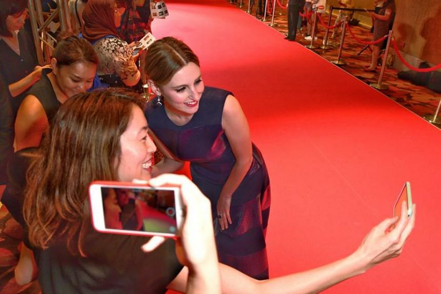 Actress Laura Carmichael, who played Lady Edith on Downton Abbey, takes a wefie with a fan at Marina Bay Sands.