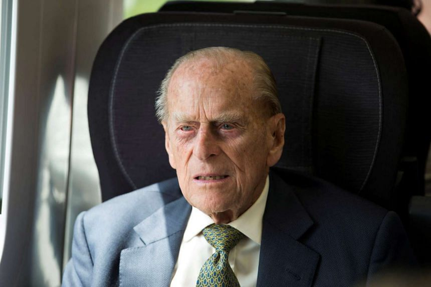 Britain's Prince Philip sits in a train on a journey marking the 175th anniversary of the first train journey by a British monarch, travelling from Slough to London Paddington, Britain on June 13, 2017.