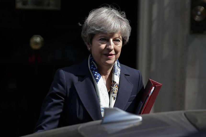 Britain's Prime Minister Theresa May leaves 10 Downing Street in central London ahead of the State Opening of Parliament on June 21, 2017.