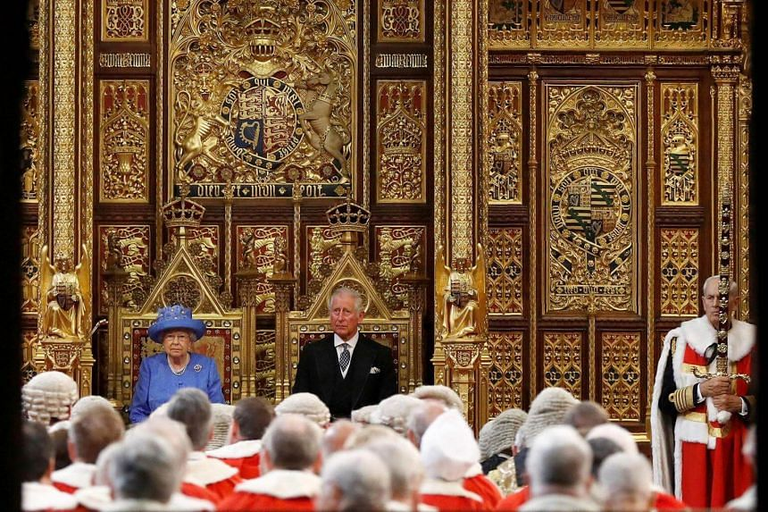 Britain's Queen Elizabeth II (left) and her son Britain's Prince Charles, Prince of Wales sit in the House of Lords during the State Opening of Parliament in the Houses of Parliament in London on June 21, 2017.