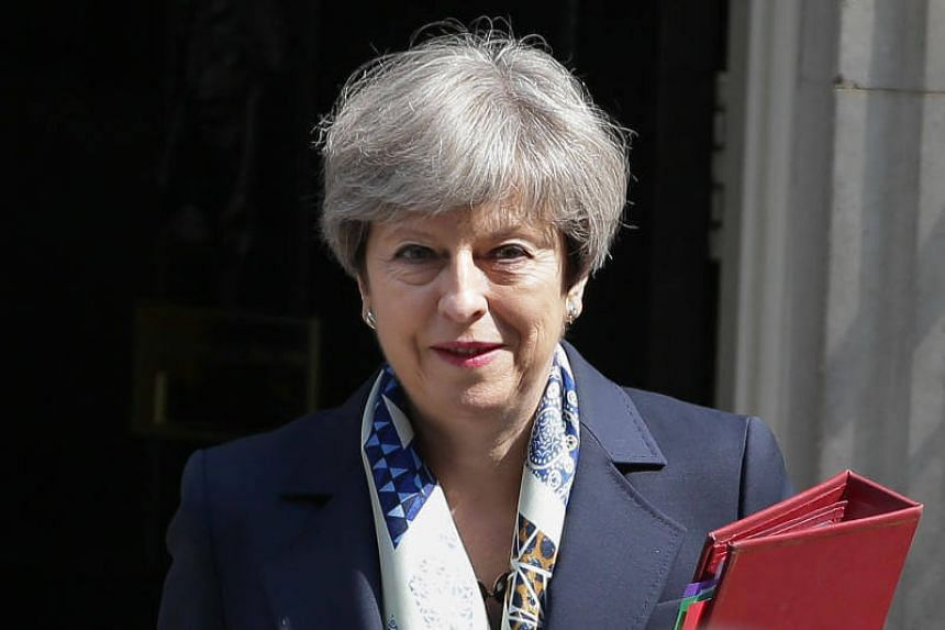 Britain's Prime Minister Theresa May leaves 10 Downing Street in central London on June 21, 2017.