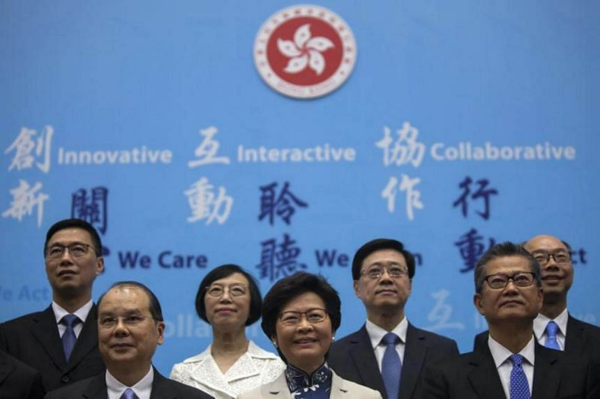 Carrie Lam Yuet-ngor (centre), Hong Kong Chief Executive-elect, poses for a group photo with her newly appointed cabinet, at Hong Kong's Central government offices, Hong Kong, China, on June 21, 2017.