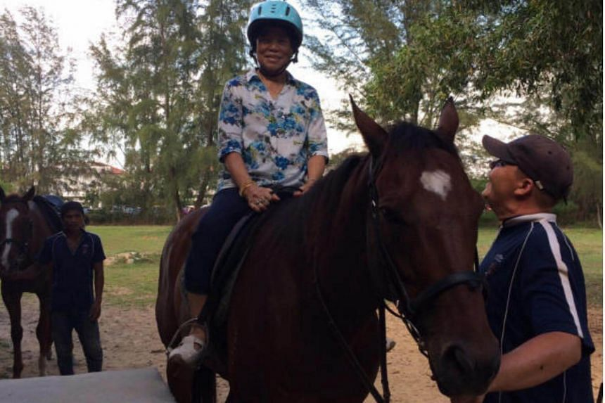 Madam Lim Ah Boey on a horse at Gallop Stables on Nov 14, 2015.