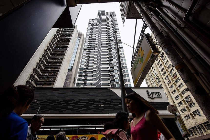 The Upton residential building (centre) in Hong Kong, where a parking space was sold recently for HK$5.18 million (S$924,000) in what is reportedly a local record. Home prices in Hong Kong remain high in spite of efforts by the authorities to cool de