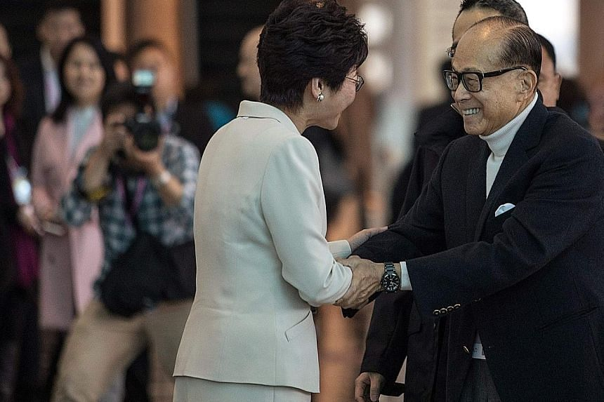 Mr Li Ka Shing with Ms Carrie Lam, before she became Hong Kong Chief Executive-elect. He could step down by his 90th birthday next year, said the Wall Street Journal, though no announcement has been made.