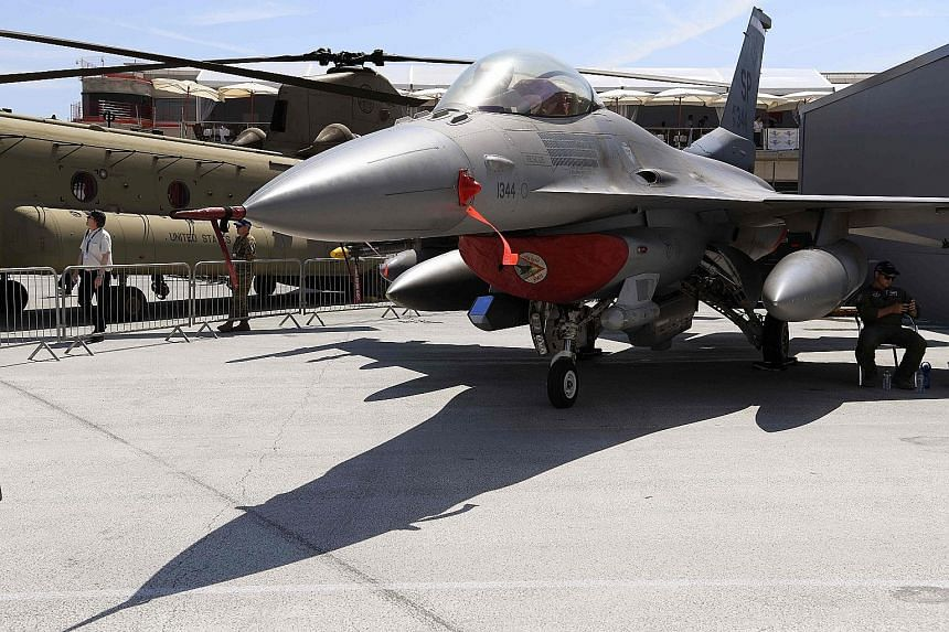 A Lockheed Martin F-16 fighter jet on display at the International Paris Air Show in Le Bourget yesterday.