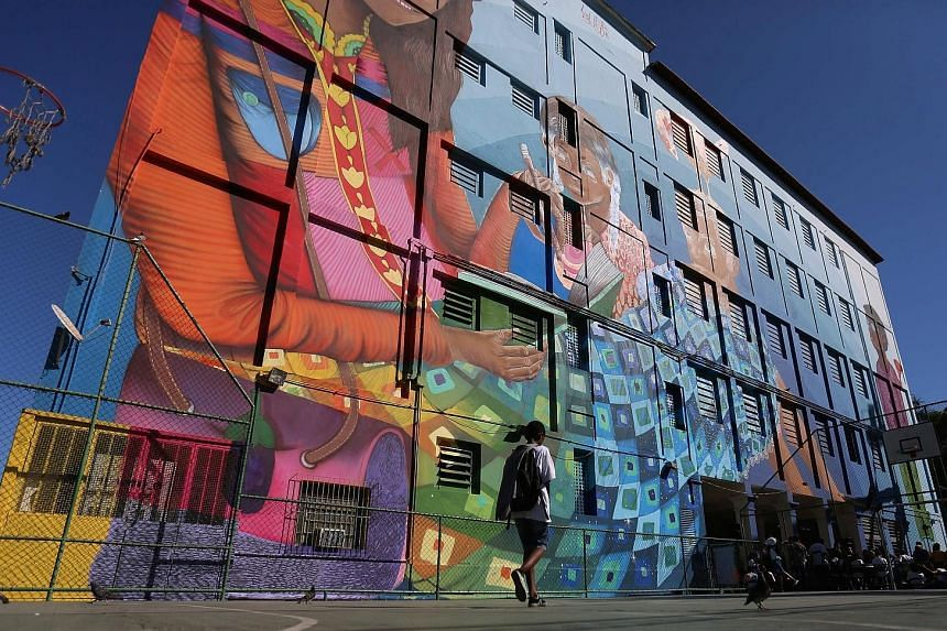 A mural entitled Cuentos (Stories) by Brazilian artist Luna Buschinelli on a public school wall adds a large dose of vibrancy to this Rio de Janeiro area. The 2,500 sq m work has been recognised by the Guinness Book of Records as the biggest work of