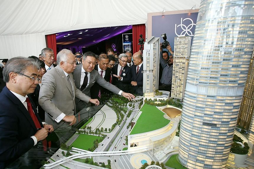 Malaysia Prime Minister Najib Razak (second from left) looking at mock-ups after the ground-breaking ceremony for Bukit Bintang City Centre and Mitsui Shopping Park LaLaport KL yesterday.