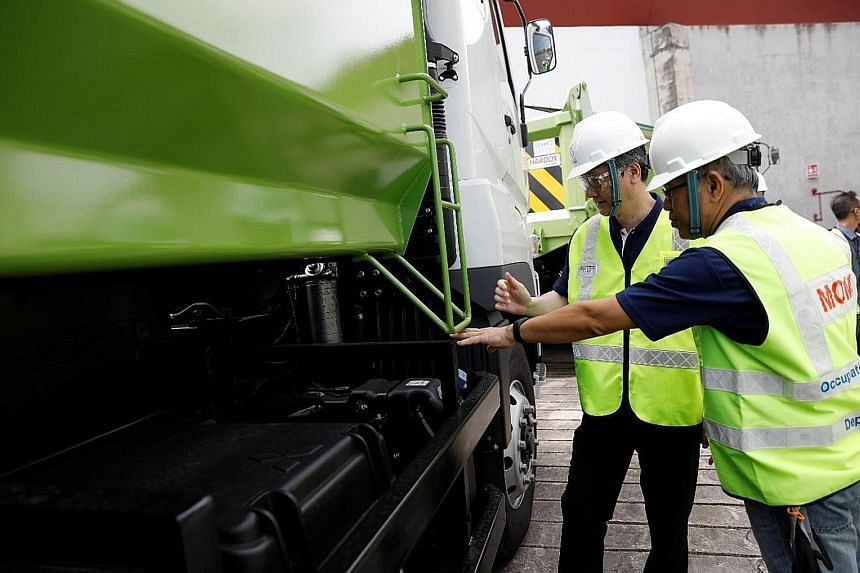 Minister of State for Manpower Sam Tan (left) joined an enforcement operation on vehicular safety at a workplace on Monday.