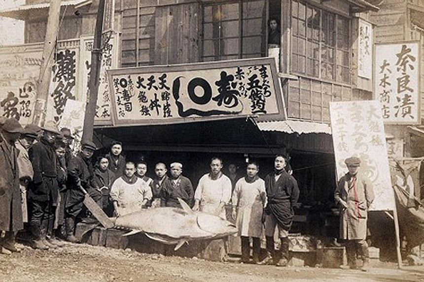 Built in 1935, Tsukiji is the world's biggest and busiest fish market. As many as 42,000 people visit it each day. Wholesalers checking the quality of fresh tuna at Tsukiji fish market before the New Year's auction in Tokyo this year. Its inner marke
