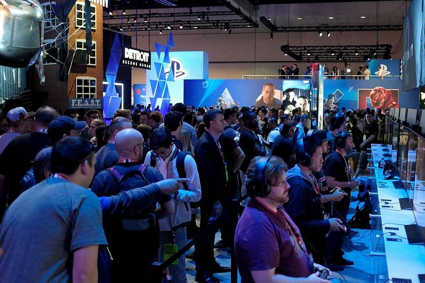 Visitors trying out games at the Sony PlayStation Booth during the Electronic Entertainment Expo 2017 in Los Angeles last week. Sony is focusing more on games as it feels that is what people are looking forward to.