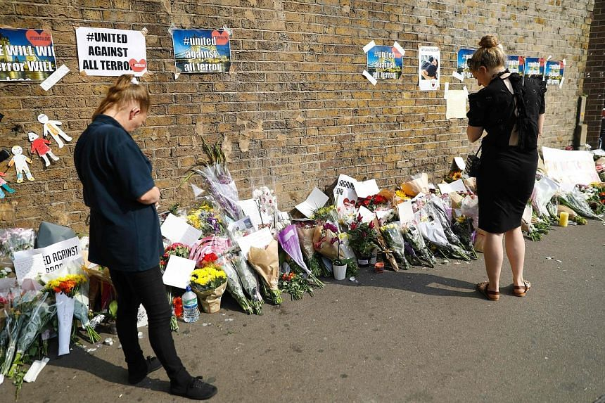 Many left flowers in the Finsbury Park area in London yesterday for the victims of Monday's attack on worshippers at a nearby mosque.