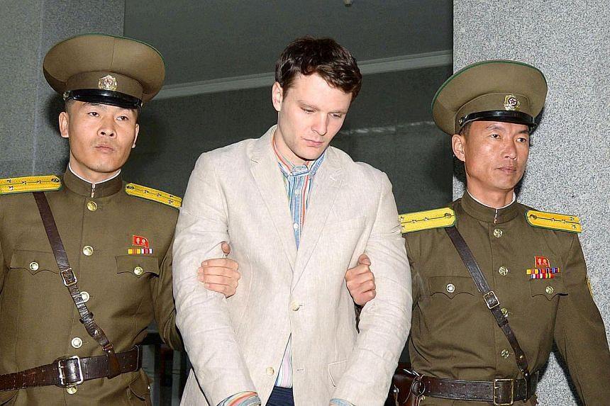 University of Virginia student Otto Warmbier on his way to court in Pyongyang in this photo released by Kyodo news agency in March last year. He was sentenced to 15 years of hard labour for stealing a political poster.