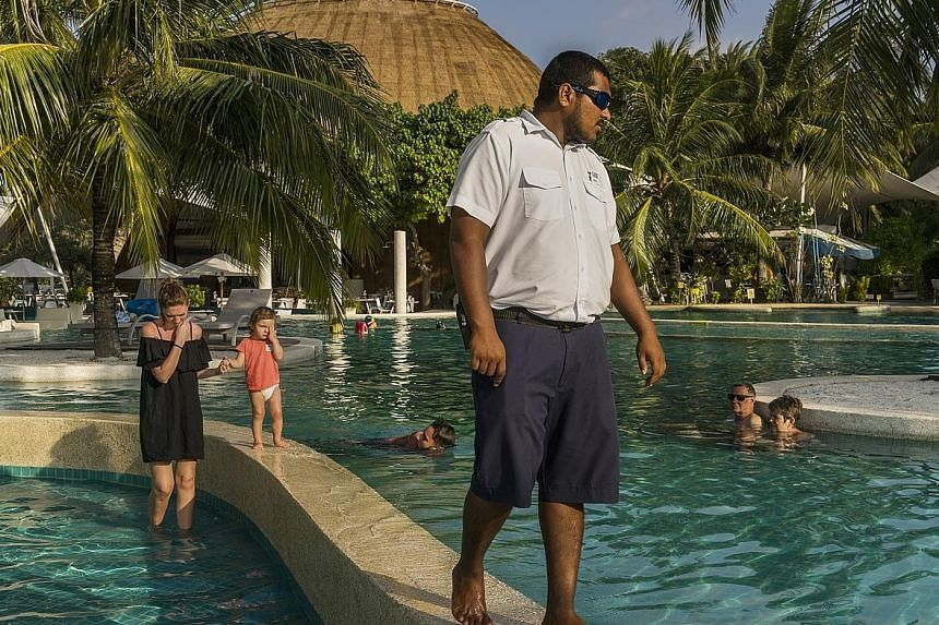 A security guard keeping watch over guests at a resort in Maldives. Many fear that the tourist haven is ill equipped to fend off a terror attack.