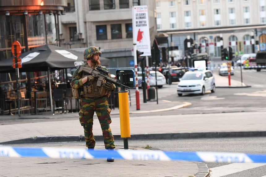 A soldier cordons off an area outside the stsation in Brussels on June 20, 2017.