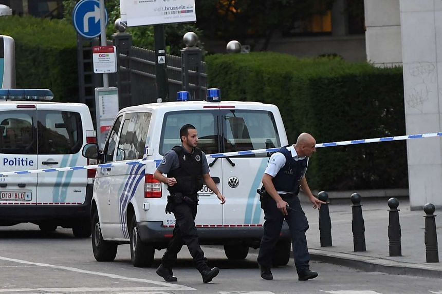 Police officials walk in a cordoned off area outside the station in Brussels on June 20, 2017.